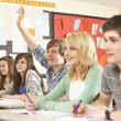 Teenage Students Studying In Classroom Answering Question — Stock Photo