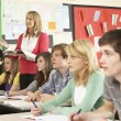 Teenage Students Studying In Classroom With Teacher — Stock Photo #11880315