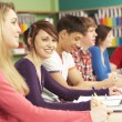 Teenage Students Studying In Classroom — Stock Photo