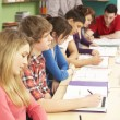 Stock Photo: Teenage Students Studying In Classroom With Tutor