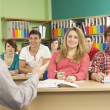 Teenage Students Studying In Classroom With Tutor — ストック写真