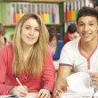 Teenage Students Studying In Classroom - Foto Stock