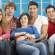 Stock Photo: Teenage Students Relaxing By Lockers In School