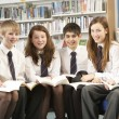 Teenage Students In Library Reading Books — Stock Photo