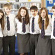 Stock Photo: Portrait Of Group Of Teenage Students In Library