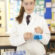 Stock Photo: Female Teenage Student In Science Class With Experiment