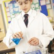 Male Teenage Student In Science Class With Experiment - Stock Photo