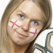 Stock Photo: Young Female Football FWith St Georges Flag Painted On Face