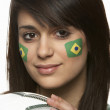 Young Female Football Fan With Brazilian Flag Painted On Face — Stock Photo