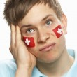 Disappointed Young Male Sports Fan With Swiss Flag Painted On Fa — Stock Photo #11880657