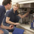 Plumber Teaching Apprentice To Fix Kitchen Sink In Home — Stock Photo