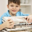 Young Boy Recyling Newspapers At Home - Stock Photo