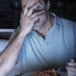 Frightened Man Enjoying Meal Whilst Watching TV — Stock Photo