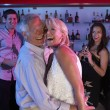 Senior Couple Having Fun In Busy Bar — Stock Photo #11880861