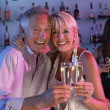 Senior Couple Having Fun In Busy Bar — Stock Photo #11880869