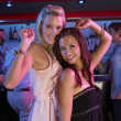 Two Young Women Having Fun In Busy Bar — Stock Photo #11880882