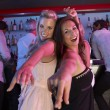 Two Young Women Having Fun In Busy Bar — Stock Photo #11880886
