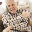 Senior Man Suffering Cardiac Arrest At Home - Foto Stock