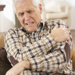Royalty-Free Stock Photo: Senior Man Suffering Cardiac Arrest At Home