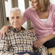 Senior Woman Caring For Sick Husband — Stock Photo #11880962