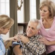 Health Visitor Taking Senior Man's Blood Pressure — Stockfoto