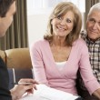 Senior Couple Talking With Financial Advisor — Stock Photo #11880976