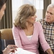 Senior Couple Talking With Financial Advisor — Stock Photo #11880977