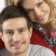 Portrait Of Happy Young Couple At Home — Stockfoto
