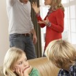 Parents Having Argument At Home In Front Of Children - Foto de Stock