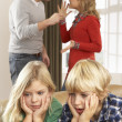 Parents Having Argument At Home In Front Of Children — Stock Photo