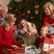 Three Generation Family Opening Christmas Gifts At Home — Stockfoto
