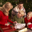 Stock Photo: Family Opening Christmas Gifts At Home