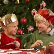 Children Making Christmas Decorations Together — Stock Photo #11881057