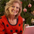 Senior Woman Shopping Online For Christmas Gifts On Phone — Stock Photo #11881080