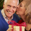 Stock Photo: Senior Couple Exchanging Christmas Gifts