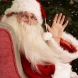 Santa Claus Sitting In Armchair In Front Of Christmas Tree — Foto de Stock