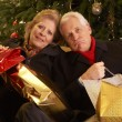 Senior Couple Returning After Christmas Shopping Trip — Stockfoto