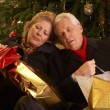 Tired Senior Couple Returning After Christmas Shopping Trip — Stockfoto