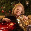 Tired Senior Woman Returning After Christmas Shopping Trip — Stockfoto