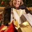 Senior Woman Returning After Christmas Shopping Trip — ストック写真