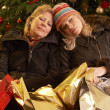 Two Women Returning After Christmas Shopping Trip — Stok fotoğraf