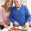 Senior Couple Making Sandwich In Kitchen — Stock Photo #11881131