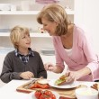 Grandmother And Grandson Making Sandwich In Kitchen — Stock Photo
