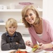 Grandmother And Grandson Making Sandwich In Kitchen — Stock Photo #11881137