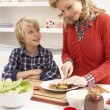 Stock Photo: Mother And Son Making Sandwich In Kitchen