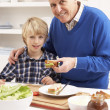 Grandfather And Grandson Making Sandwich In Kitchen — Foto Stock