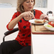 Disabled Senior Woman Making Sandwich In Kitchen — Stock Photo
