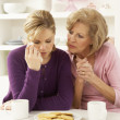 Foto Stock: Mother Consoling Grown Up Daughter