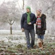 Couple On Winter Walk Through Frosty Landscape — Stock Photo