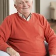 Senior Man Relaxing In Chair At Home — Stock Photo #11881245
